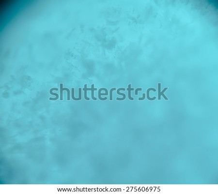 Extremely close up image of snow texture, blue toning. - stock photo