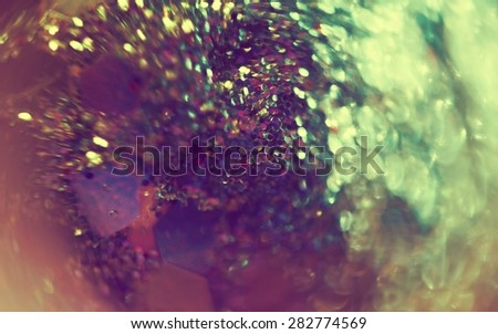 Extremely close up photo of glittering surface, abstract background. - stock photo