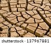 Extremely cracked earth. Low angle. - stock photo