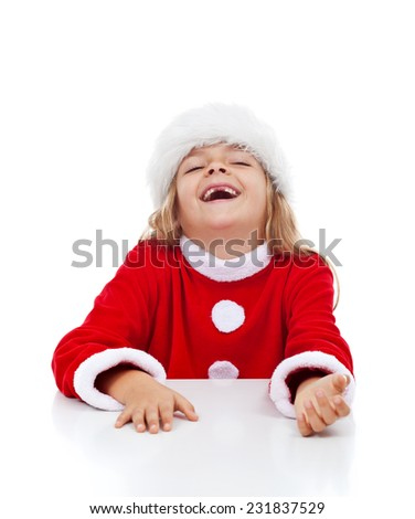 Extremely happy little girl with missing teeth laughing in christmas outfit - stock photo