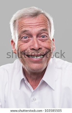 Extremely happy old man. Maybe he won the lottery - stock photo