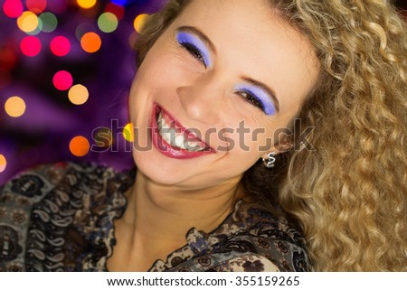 Extremely happy woman laughing at the New Year party - stock photo