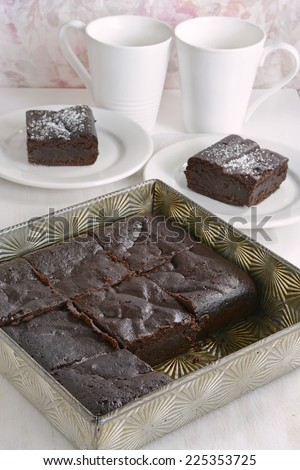 Extremely rich fudge chocolate brownies made without any grains, totally gluten free, in vertical format - stock photo