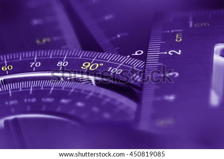 extremely selective focus a part of  the silver precision measurement tool , purple glowing luminescence color - stock photo