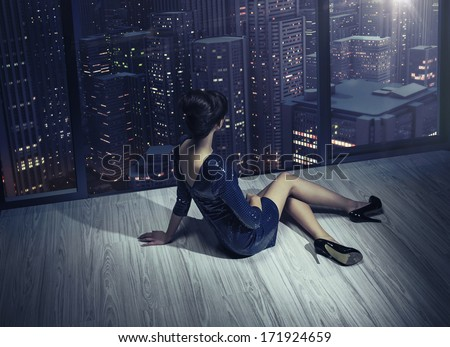Extremely sexy woman wearing dress - stock photo