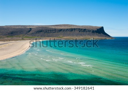 Extremly beautiful bay with mighty golden beaches and turquise sea in the West Fjords, Iceland. Panoramic photo - stock photo