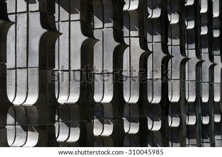 Extruded brick wall with light, vertical arrangements