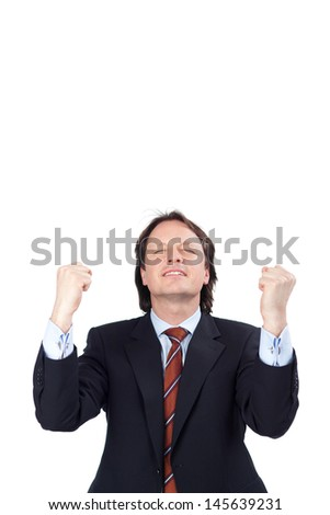 Exultant businessman raising his fists in jubilation as he celebrates a victory or success isolated on white - stock photo
