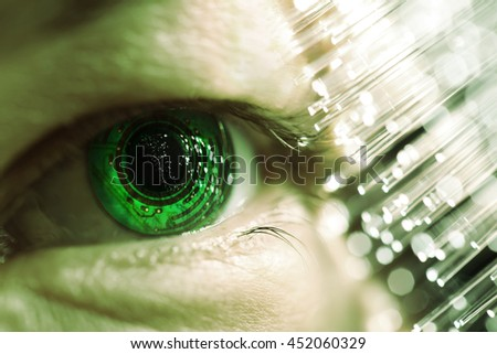 eye and electronic circuit with fiber optics - stock photo