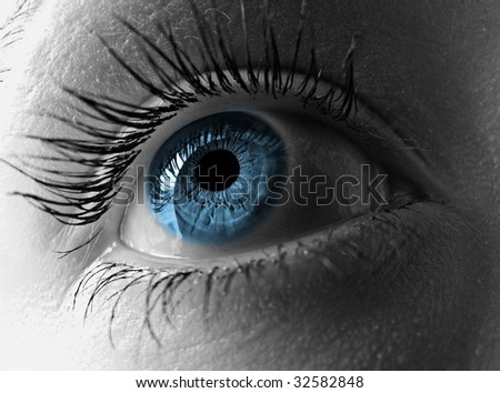 Eye close-up in blue and b/w duotone. - stock photo