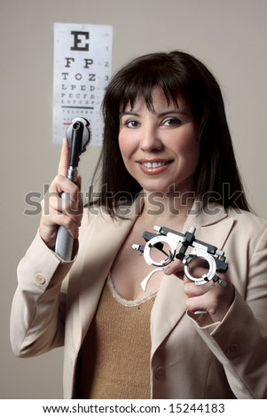 Eye doctor with instruments for checking eyesight. - stock photo