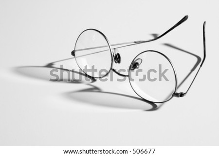 Eye glasses and shadow in black and white.
