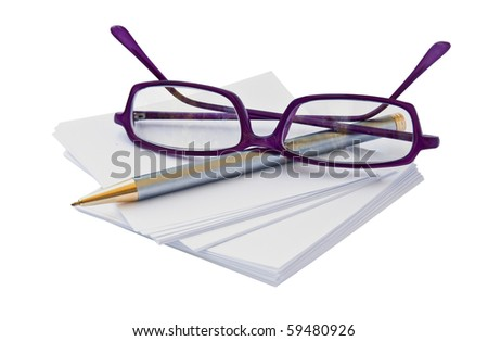 Eye glasses and sheets of paper to take notes. - stock photo