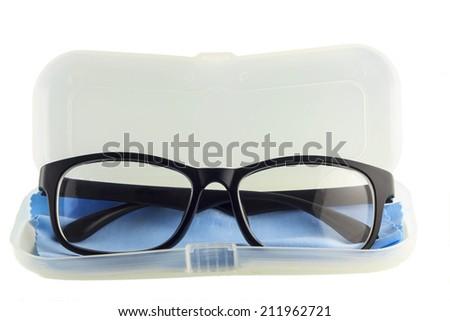 Eye glasses, Black eye glasses on cover of case isolated on white background. - stock photo