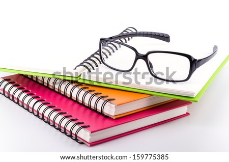 Eye glasses on book - stock photo