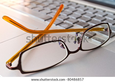 eye glasses on the computer - stock photo
