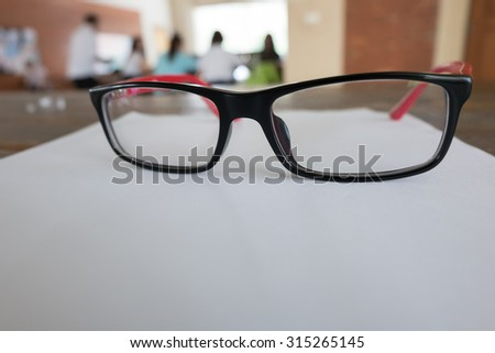 eye glasses placed on a blank paper sheet