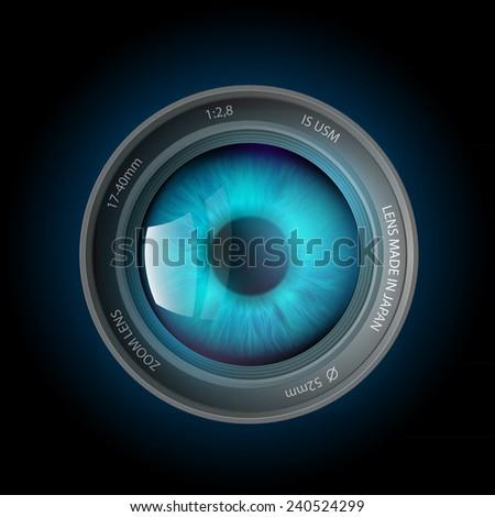 eye inside the camera lens - stock photo