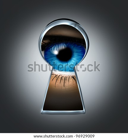 Eye looking through a keyhole representing the privacy and security concept of spying and secrecy of private content from surveillance with a blue human eyeball behind a door in the shadows. - stock photo