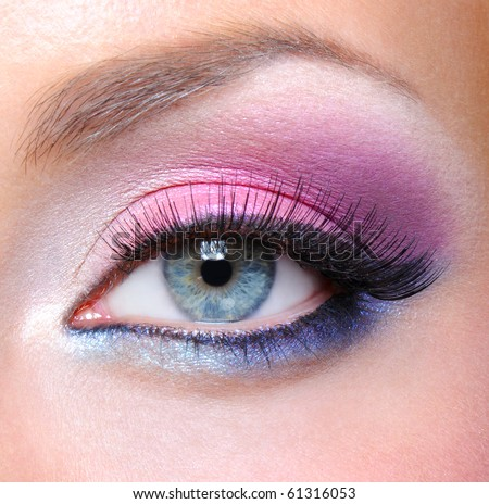 Eye make-up with bright saturated colors - macro shot - stock photo
