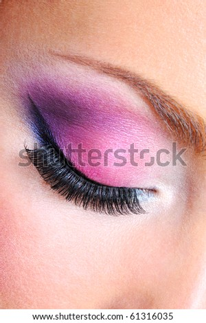 Eye make-up with bright saturetad colors - macro shot - stock photo