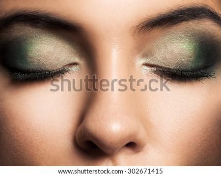 Eye Makeup. Beautiful Eyes Retro Style Make-up. Holiday Makeup detail. Eyeliner - stock photo