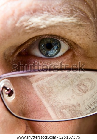 Eye of the businessman, natural reflexion in eyes and glasses