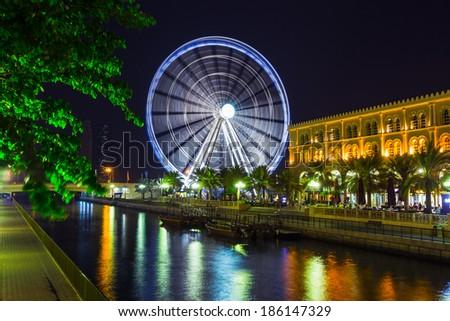 Eye of the Emirates - ferris wheel in Al Qasba - Shajah, United Arab Emirates - stock photo