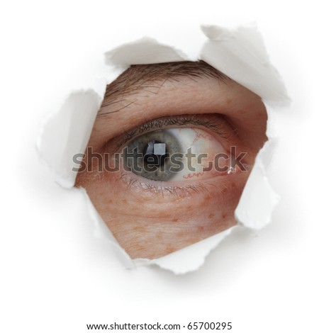 Eye of the person in a hole close up isolated on white background