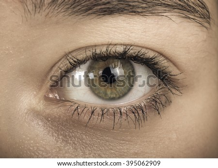 Eye of young girl close up. Toned. - stock photo