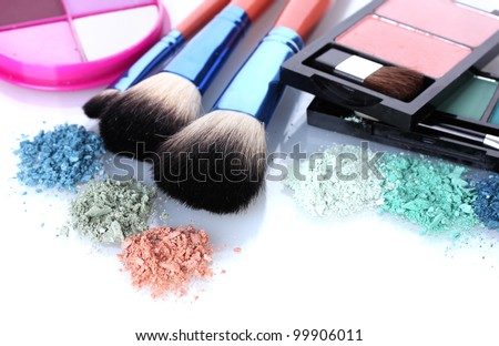 eye shadow and make-up brushes isolated on white - stock photo