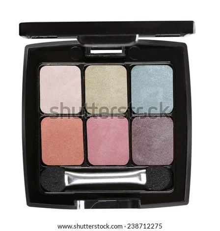 Eye shadows with eye shadow brush on white background. - stock photo