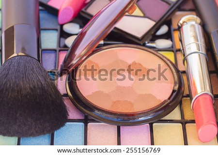 Eye shadows with powder, lipstick and brushes  - stock photo