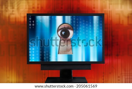 eye spying from monitor keyhole - stock photo