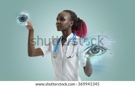 Eye surgeon working with virtual futuristic interface - stock photo