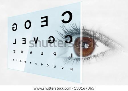 Eye test at the optometrist - stock photo