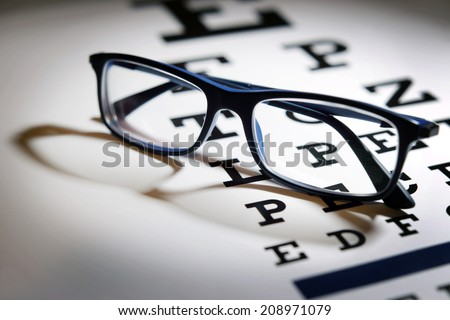 Eye test chart and eye glasses. Studio shot.