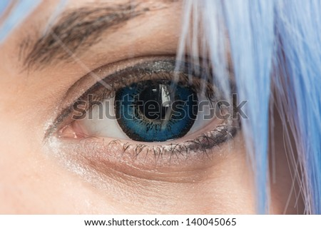 Eye with a decorative color lens - stock photo