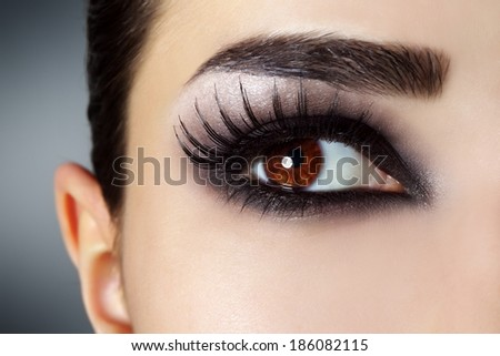 Eye with black fashion make-up - stock photo