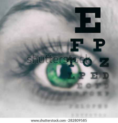 Eye with test vision chart close up - stock photo
