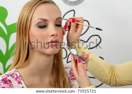 Eyebrow shaping in professional studio. - stock photo