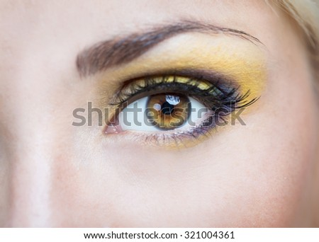 Eyed girl with bright makeup - stock photo