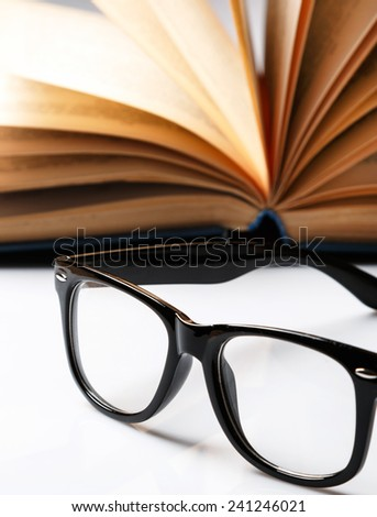 Eyeglasses and book on the table
