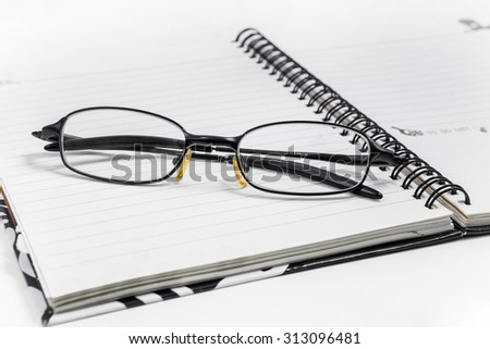eyeglasses on a blank paper