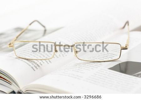 eyeglasses on a book pages (shallow dof)