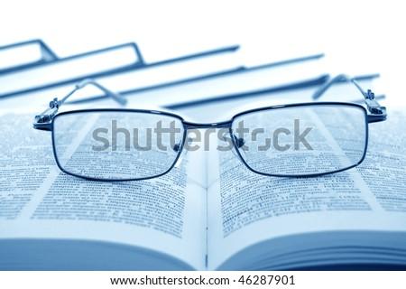 Eyeglasses on books - stock photo