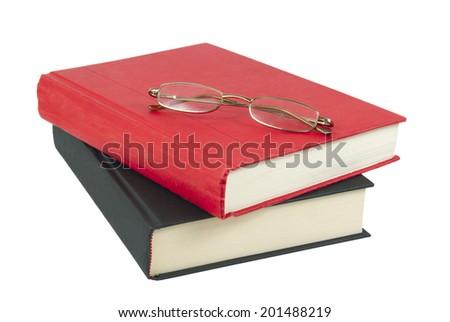 Eyeglasses on books Isolated on white background - stock photo