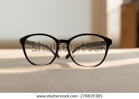 Eyeglasses on the bed. - stock photo