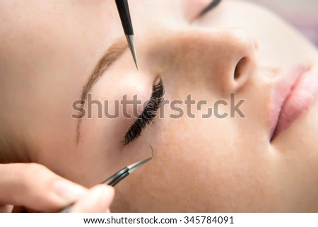 Eyelash Extension Procedure.  Woman Eye with Long Eyelashes. Lashes. Close up, selective focus.