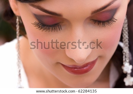 eyelash setup by makeup artist to a beautiful young lady - stock photo